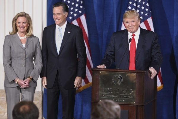 Donald Trump, right, endorses Republican presidential candidate Mitt Romney as Romney's wife, Ann, looks on Feb. 2, 2012, at the Trump International Hotel & Tower in Las Vegas. K.M. Cann ...