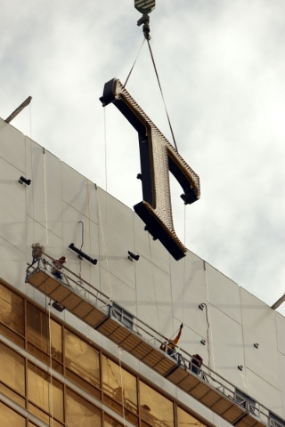 """Construction crews move a 20-foot-tall """"T"""" into place atop the 64-story Trump International in July 2007. The hotel opened in March 2008. K.M. Cannon/Las Vegas Review-Journal file"""