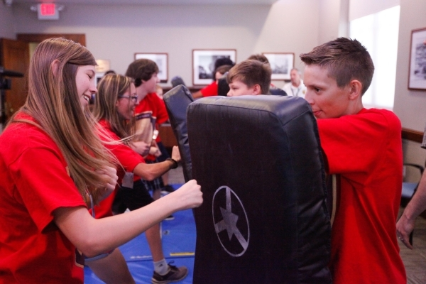 Alexandra Vasknetz, left, and Cody Raymond participate in a self-defense drill during The Mob Museum's Secret Agents of Summer day camp. Kids ages 11 to 14 were introduced to a variety of la ...