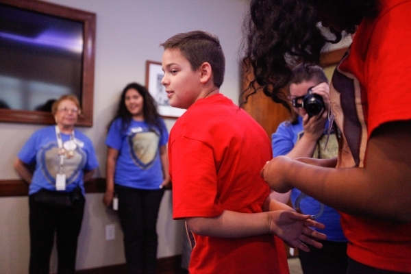 Alex Nicola is handcuffed in a practice drill at The Mob Museum during the Special Agents of Summer Camp. Later he would go undercover in a sting operation exercise as a part of the camp. (JAMES T ...