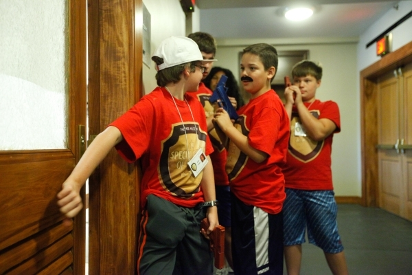 Jason Stiefel and other campers simulate entering a suspect's home during The Mob Museum's Special Agents of Summer day camp, which taught kids ages 11 to 14 about law enforcement and  ...
