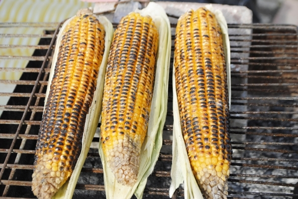 Various chefs offer different advice on grilling corn, but all grill it in the husk. (Thinkstock)