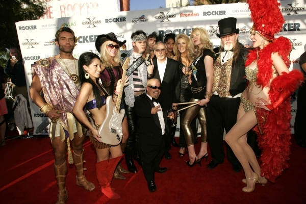 Actor Rainn Wilson, fourth from left, stands next to actor Dennis Hopper, the chairman of the CineVegas creative advisory board, as they are surrounded by an entourage of characters at the opening ...
