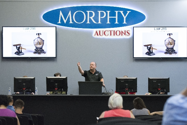 Auctioneer Dan Sidlow moderates bids at Morphy Auctions, 4520 Arville St., in Las Vegas, Saturday, August 1, 2015. Morphy's Auctions is auctioning of more than 1,600 props, apparel and antiq ...