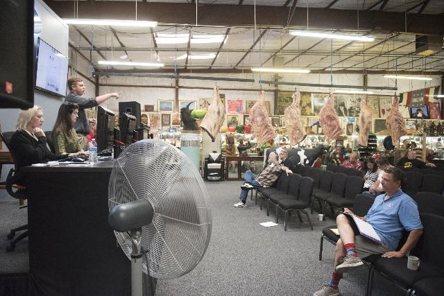 Auctioneer Adam Firestone, above left, moderates bids at Morphy Auctions, 4520 Arville St., in Las Vegas, Saturday, August 1, 2015. Morphy's Auctions is auctioning of more than 1,600 props,  ...