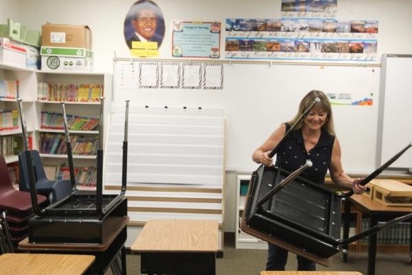 Vivian Cushman prepares her third-grade classroom for the school year at Piggott Elementary School, 9601 Red Hills Road, Aug.  3.  (James Tensuan/View) (Follow
