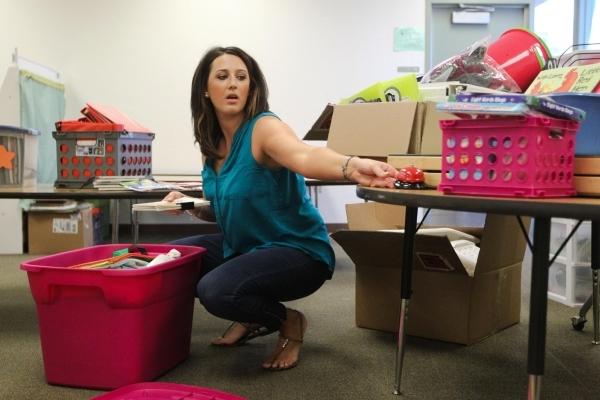 Alyssa Horton organizes her kindergarten classroom at Piggott Elementary School, 9601 Red Hills Road, Aug.  3. (James Tensuan/View) (Follow