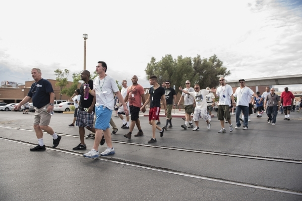 Participants start the 1.2 mile walk from the Review-Journal to the Las Vegas Rescue Mission and back during the fourth annual Walk a Mile in My Shoes event benefitting those struggling to survive ...