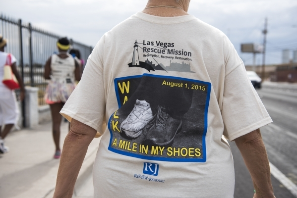 A participant walks the 1.2 mile distance from the Review-Journal to the Las Vegas Rescue Mission and back during the fourth annual Walk a Mile in My Shoes event benefitting those struggling to su ...