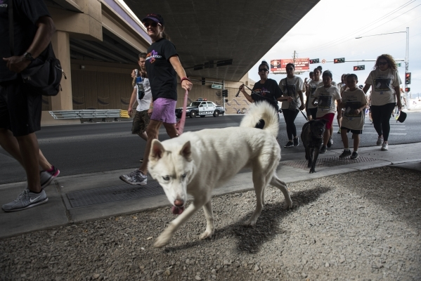 Participants walk the 1.2 mile distance from the Review-Journal to the Las Vegas Rescue Mission and back during the fourth annual Walk a Mile in My Shoes event benefiting those struggling to survi ...
