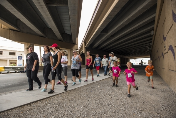 Participants walk the 1.2-mile distance from the Review-Journal building on 1111 Bonanza Road in downtown Las Vegas to the Las Vegas Rescue Mission and back Saturday during the fourth annual Walk  ...