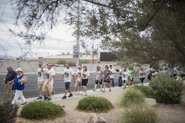 Participants walk the 1.2 mile distance from the Review-Journal to the Las Vegas Rescue Mission and back during the fourth annual Walk a Mile in My Shoes event benefitting those struggling to surv ...