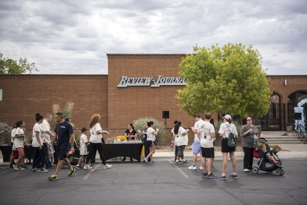 Participants return from the 1.2 mile distance from the Review-Journal to the Las Vegas Rescue Mission and back during the fourth annual Walk a Mile in My Shoes event benefitting those struggling  ...