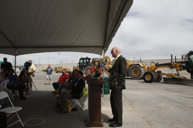 Clark County Commissioner Larry Brown speaks during the ground breaking ceremony for the Centennial Bowl Interchange improvement project at a construction near Interstate U.S. 95 and the westbound ...