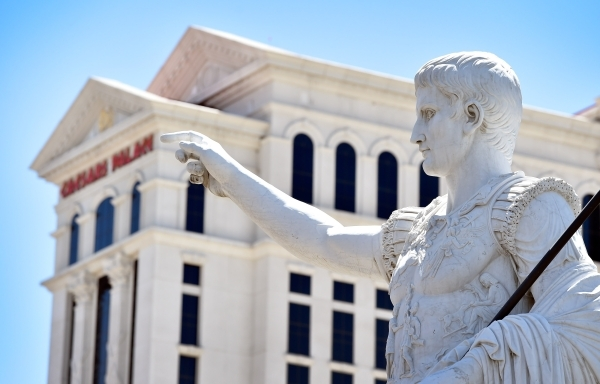 The finger of a statue points Monday to one of the hotel towers at Caesars Palace. Caesars Entertainment Corp. said Tuesday its net revenue increased 17.4 percent in the second quarter.   David Be ...