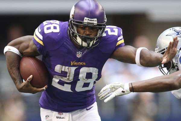 Minnesota Vikings running back Adrian Peterson, shown against the Dallas Cowboys in a game on Nov. 3, 2013, returns to the field Sunday against the Pittsburgh Steelers in the annual Hall of Fame G ...
