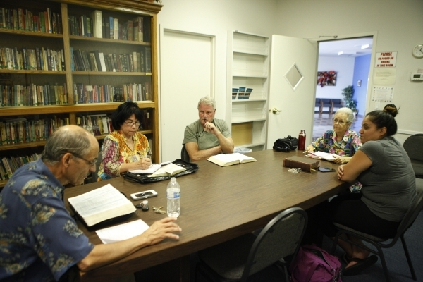 Seventh-day Adventist congregants, from left, Pastor Peter Neri, Myrlene Abellana, Hoot Gibson, Jean Gaddy and Gem Poo take part in a midweek prayer meeting at Paradise Seventh-day Adventist Churc ...