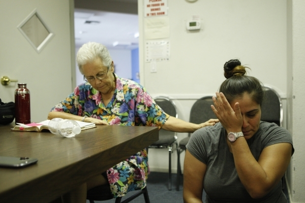 Seventh-day Adventist Church members Jean Gaddy, left, and Gem Poo participate in a prayer meeting at Paradise Seventh-day Adventist Church. Prayer for those in need and studying the Bible are imp ...