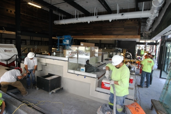 Workers piece together the new Starbucks at the Grand Bazaar shopping center on Tuesday, August 4 2015. The new Starbucks will feature elevated seating and is slated to open later this month. JAME ...