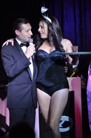 """Frank Sinatra (David DeCosta) cozies up to a Playboy bunny (Joelle Righetti) during """"The Rat Pack Is Back."""" (Bill Hughes/Las Vegas Review-Journal)"""