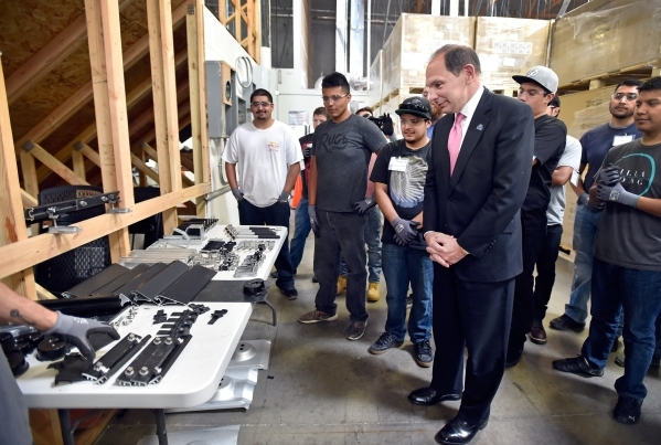 Veterans Affairs Secretary Robert McDonald visits with employees during a tour of a SolarCity warehouse in North Las Vegas on Tuesday, Aug. 4, 2015. McDonald commended the business for having hire ...