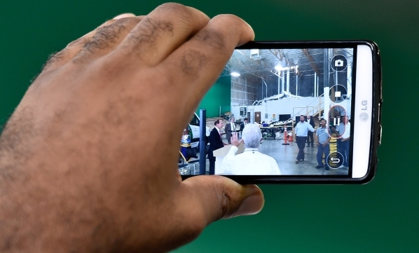 Veterans Affairs Secretary Robert McDonald is recorded with a mobile device while he speaks at a SolarCity warehouse in North Las Vegas on Tuesday, Aug. 4, 2015. McDonald commended the business fo ...