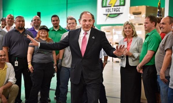 Veterans Affairs Secretary Robert McDonald, center, visits with employees during a tour of a SolarCity warehouse in North Las Vegas on Tuesday, Aug. 4, 2015. McDonald commended the business for ha ...