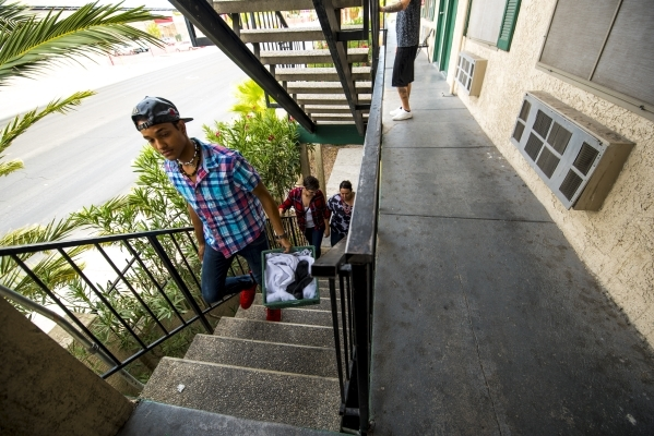 Edward Aponte, 23, carries his laundry up the stairs at the Shannon West Homeless Youth Center in Las Vegas on Tuesday, Aug. 4, 2015. (Joshua Dahl/Las Vegas Review-Journal)
