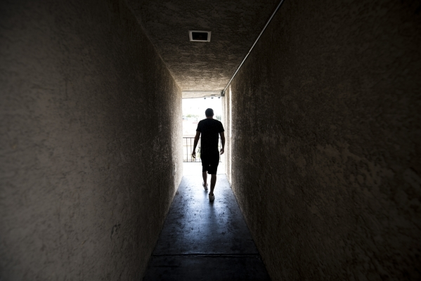 Tyler Vincent, 22, walks to his room at the Shannon West Homeless Youth Center in Las Vegas on Tuesday, Aug. 4, 2015. (Joshua Dahl/Las Vegas Review-Journal)