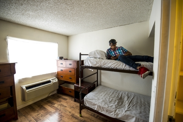 Edward Aponte, 23, sits on his bed at the Shannon West Homeless Youth Center in Las Vegas on Tuesday, Aug. 4, 2015. (Joshua Dahl/Las Vegas Review-Journal)