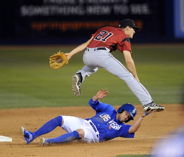 Danny Muno of the Las Vegas 51s, seen sliding into second base, has been promoted to the New York Mets and optioned back to Las Vegas several times this season.   Josh Holmberg/Las Vegas Review Jo ...