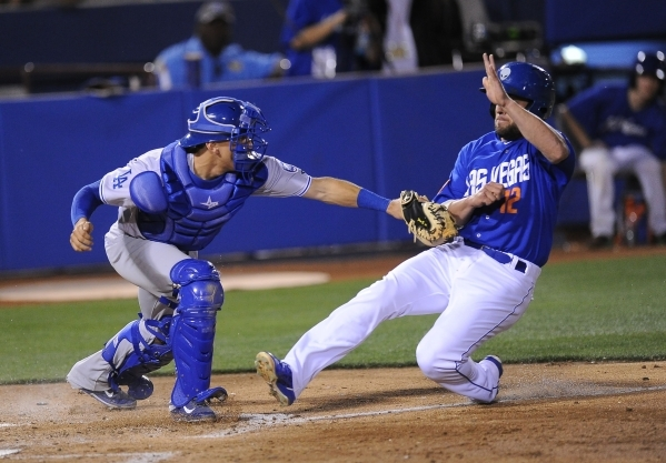 """Las Vegas 51s infielder Danny Muno, seen coming into home plate, says, """"When the (Mets) are winning, it's motivating and encouraging for all of us.""""   Josh Holmberg/Las Vegas Revie ..."""