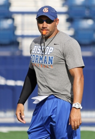 Bishop Gorman coach Kenny Sanchez runs offensive drills with the football team at Bishop Gorman High School Wednesday, Aug. 5, 2015, in Las Vegas. Sanchez is the Gaels´ new head coach, a positi ...
