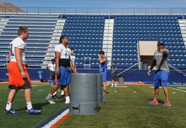 Bishop Gorman football coach Kenny Sanchez, right, directs players during a noncontact practice Wednesday. The Gaels' longtime defensive coordinator was elevated to head coach this season af ...