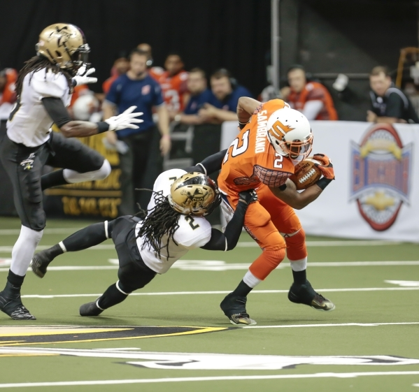 Las Vegas Outlaws defensive back Demarcus Robinson (2) holds on to Spokane Shocks wide receiver Jabin Sambrano (2) during a football game between the Las Vegas Outlaws and the Spokane Shocks  at t ...