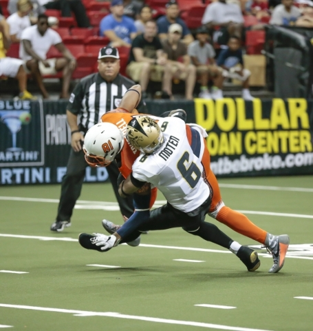 Las Vegas Outlaws defensive back, Eddie Moten (6) makes a tackle on Spokane Shocks wide receiver Nick Truesdell (81) during a football game between the Las Vegas Outlaws and the Spokane Shocks  at ...