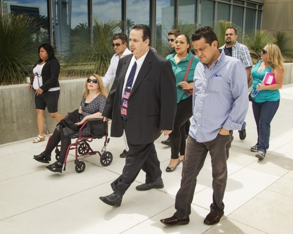 Leon Benzer, center, the mastermind of the scheme to take over and defraud HOAs in Las Vegas, leaves the Lloyd D. George U.S. Courthouse after he was sentenced to 15 1/2 years  in prison on Thursd ...