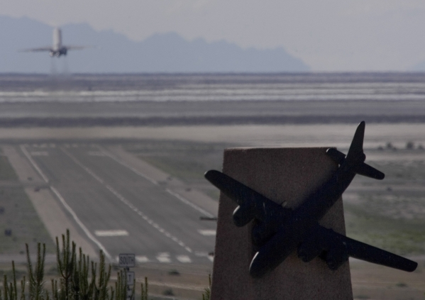 A monument dedicated to the members of the 509th Composite Group is seen in West Wendover while a plane departs Wendover Field for Las Vegas on June 1, 2005. Wendover Field was the training site f ...