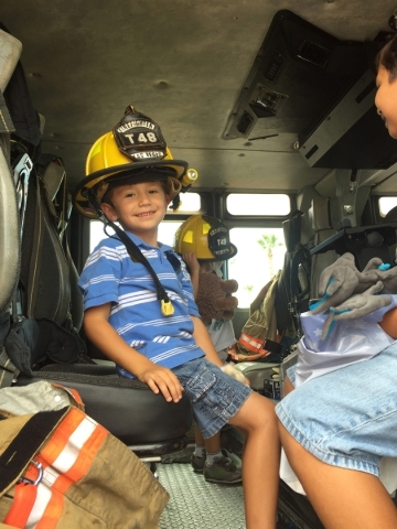 AMR responders talk about what happens during ambulance rides with Tristan Bittner, left, and Ashton Bittner during the Teddy Bear Clinic at Centennial Hills Hospital, 6900 N. Durango Drive, Aug.  ...