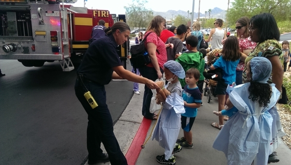 Children dress up as doctors and chat with Las Vegas Fire & Rescue workers during the Teddy Bear Clinic at Centennial Hills Hospital, 6900 N. Durango Drive, Aug. 5. (Special to View)