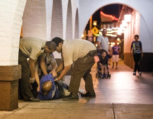 EL Cortez hotel-casino personnel detain a man outside the casino. (Jeff Scheid/Las Vegas Review-Journal)