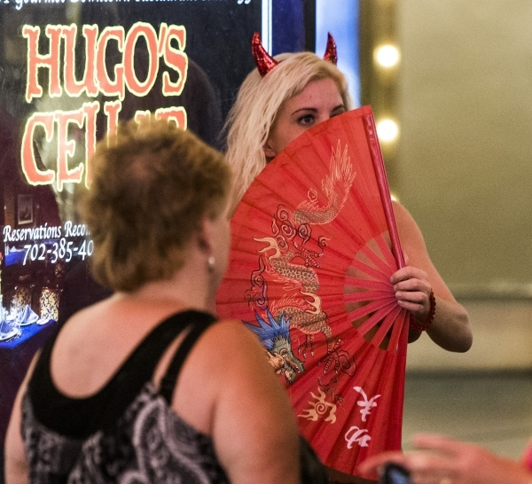 Misty Sins, her stage name, performs on the Fremont Street Experience. She has working on Fremont Street for the past 4   years to make money to pay for massage school. (Jeff Scheid/Las Vegas Revi ...