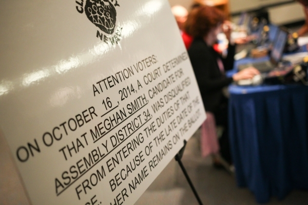 A sign stating that Assembly District 34 candidate Meghan Smith has been disqualified is seen at the early voting polling site at Sahara West Library on Oct. 22, 2014. The sign also adds that Smit ...