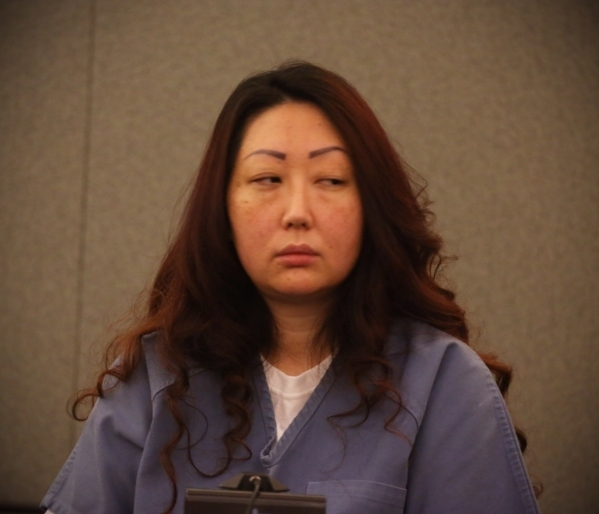 Gloria Lee appears in court on Thursday, Aug. 6, 2015, as her attorneys ask for her released so she can be treated during a high-risk pregnancy. Lee,  who is serving a 5- to 15-year sentence after ...