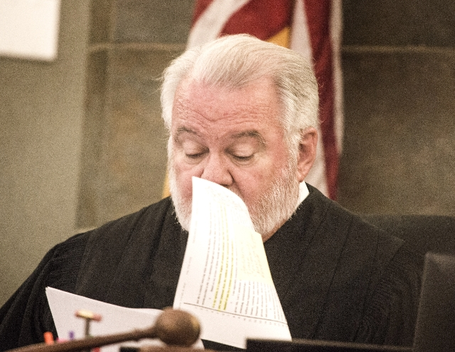 District Judge Jim Crockett reads a statement by Gloria Lee, imprisoned for torching a pet shop with 27 animals, during a hearing at Regional Justice Court  on Thursday, Aug. 6, 2015. Lee is reque ...
