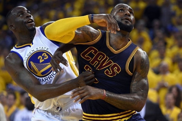 Cleveland Cavaliers forward LeBron James and Golden State Warriors forward Draymond Green fight for a rebound during Game 1 of the NBA Finals on June 4. James and several other of the NBA's  ...
