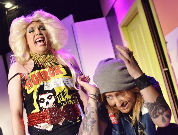 """Cory Benway, left, as Hedwig, makes Jamie Riviere, as Yitzhak, cringe in """"Hedwig and the Angry Inch,"""" now being performed at the Onyx Theatre. (Bill Hughes/Las Vegas Review-Journal)"""