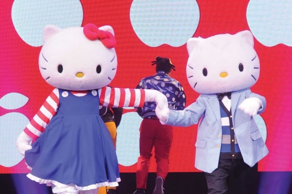 Hello Kitty and Dear Daniel dance together during a stage show at Hello Kitty's Supercute Friendship Festival. (Courtesy photo)