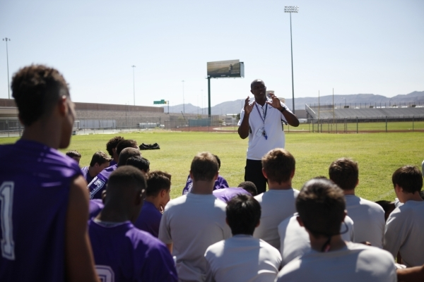 """Randall Cunningham speaks to his players during practice Monday at Silverado High School. """"Right now, we're in the learning stages,"""" he said after the noncontact practice.   ERIK V ..."""