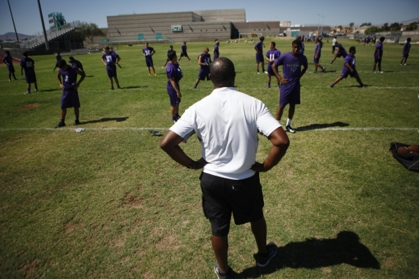 Pastor and former NFL quarterback Randall Cunningham, Silverado High's coach, watches his players stretch Monday.   ERIK VERDUZCO/LAS VEGAS REVIEW-JOURNAL Follow him